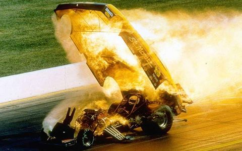 Ron Dudley's Funny Car explodes in a fireball as he crosses the finish line at Indianapolis Raceway Park during qualifying for the 33rd running of the U.S. Nationals in 1987. Dudley escapes serious injury.