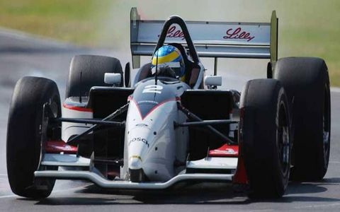 Sebastien Bourdais smokes the tires on the way to capturing the pole of the Tecate Telmex Monterrey Grand Prix in 2003.