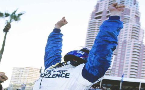 Paul Tracy celebrates winning the CART Champ Car World Series championship at Surfers Paradise, Australia, in October 2003.