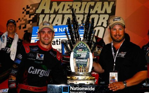 Ricky Stenhouse Jr., left, poses with one of the more unusual trophies in NASCAR.