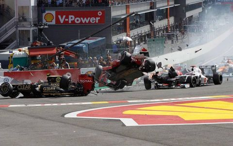 Fernando Alonso goes airborne during a first-lap crash at Spa on Sunday.