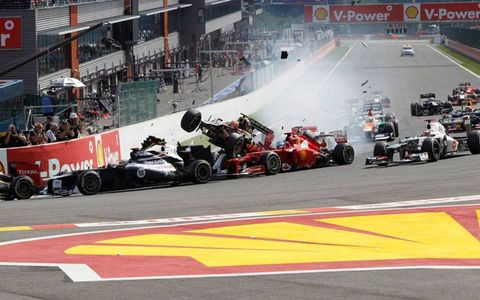 A huge crash on the first lap collected several drivers, including points leader Fernando Alonso.