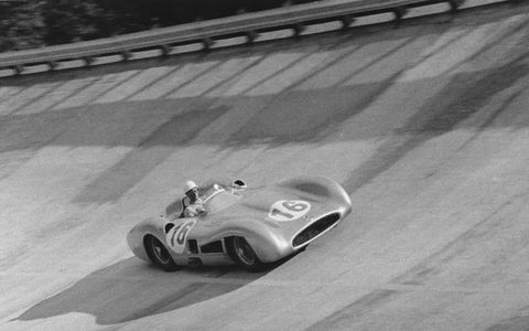Sir Stirling Moss in his Mercedes-Benz W196 flys around the banking during the 1955 Italian Grand Prix at Monza.