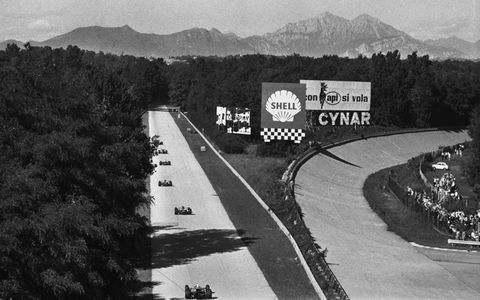 F1 cars fly past the old banking, which was no longer in use, during the 1970 Italian Grand Prix.