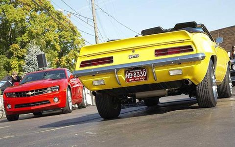 Past meets future: Troy Gould's yellow 1969 Camaro and the Chevy's 2010 Camaro.