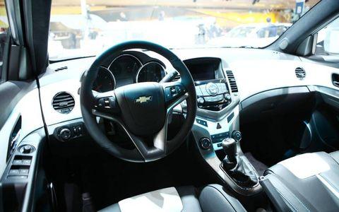 Motor vehicle, Steering part, Automotive mirror, Automotive design, Steering wheel, Transport, Vehicle audio, Center console, White, Technology,