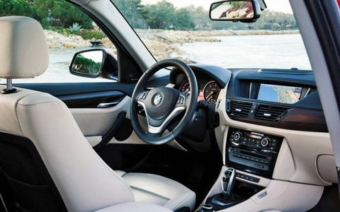 Just as with its larger X3 and X5 siblings, there's nothing too dramatic about the X1's exterior styling. Inside, the cabin is well trimmed.