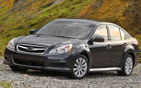 Tire, Wheel, Daytime, Vehicle, Glass, Infrastructure, Headlamp, Rim, Car, Automotive lighting,