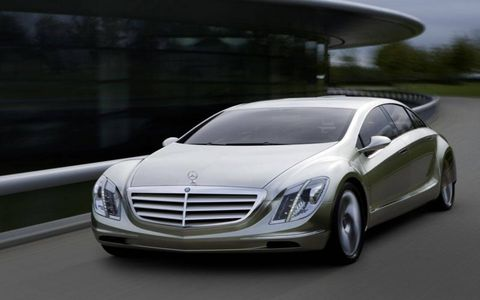 Mode of transport, Automotive design, Automotive mirror, Transport, Vehicle, Land vehicle, Grille, Automotive parking light, Hood, Car,