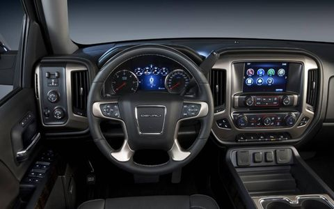 The interior of the 2014 GMC Sierra 1500 is well appointed for a truck.