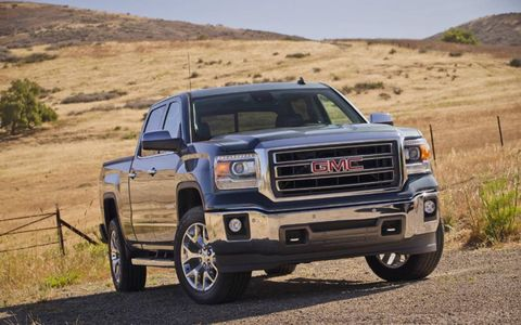 The 2014 GMC Sierra 1500 is equipped with a 5.3-liter V8 that produces 355 hp and 383 lb-ft of torque.