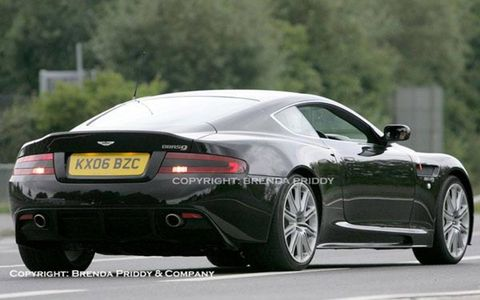 Aston plans to build 300 road versions of the car based on the DB9. DBRS9, spied testing at Nürburgring, features a wider track, lower ground clearance, bolder air intakes and a performance boost from 450 to 500 hp from the V12 under the hood. The Bond movie is out in November, so look for the DBRS9 soon thereafter, priced at about $250,000.