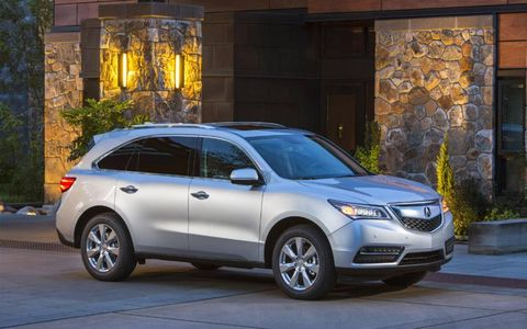 The 2014 Acura MDX SH-AWD is equipped with a 3.5-liter V6 mated with a six-speed automatic.