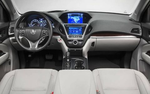 The navigation/infotainment system in the 2014 Acura MDX SH-AWD is a bit frustrating, we would just like the old buttons back.