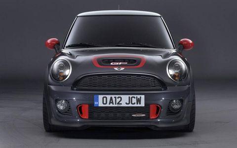 Motor vehicle, Automotive design, Automotive mirror, Vehicle, Land vehicle, Automotive lighting, Grille, Headlamp, Car, Red,