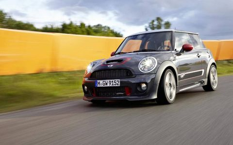 Automotive design, Vehicle, Vehicle door, Car, Grille, Mini cooper, Alloy wheel, Hatchback, Automotive exterior, Rim,
