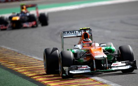 2012 Belgian Grand Prix: Nico Hulkenberg, Force India VJM05 Mercedes, leads Mark Webber, Red Bull RB8 Renault.