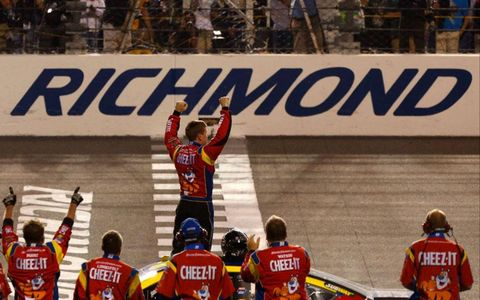Carl Edwards and crew appreciate their fans at Richmond on Saturday night.