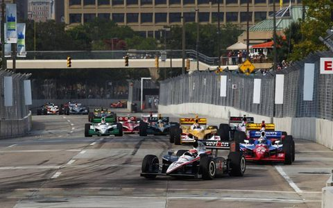 The No. 2 driven by Oriol Servia leads Tony Kanaan's No. 82 through the hairpin in Baltimore, Md. Photo by: Phillip Abbott/LAT Photographic