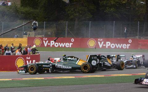 The spinning car of Jarno Trulli gets tangled with Team Lotus teammate Heikki Kovalainen during the Grand Prix of Belgium at Spa-Francorchamps on Aug. 28. Photo by: Steve Etherington/LAT Photographic