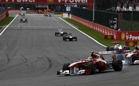 Felipe Massa leads Ferrari teammate Fernando Alonso into turn one with Lewis Hamilton in pursuit. Photo by: Andrew Ferraro/LAT Photographic