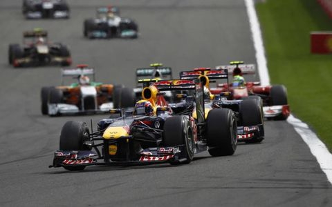 Red Bull Racing's Mark Webber is followed closely by teammate Sebastian Vettel. The pair went on to finish one-two with Vettel leading the way. Photo by: Andrew Ferraro/LAT Photographic