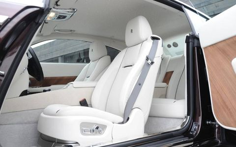 Luxurious front seating in the 2014 Rolls Royce Wraith.