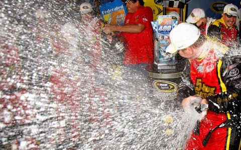 Clint Bowyer helps close out a long night of racing with a champagne shower.
