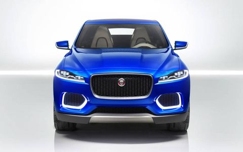 Motor vehicle, Automotive design, Blue, Hood, Vehicle, Automotive lighting, Headlamp, Grille, Automotive exterior, Car,