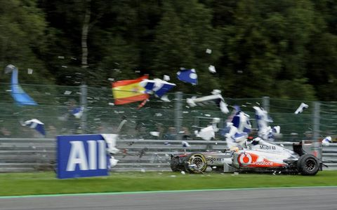 Race to Forget//Lewis Hamilton would like to forget the Formula One race weekend at Spa in Belgium after crashing out and knocking himself unconscious for a few seconds. Hamilton hit the wall after colliding with another car at the end of the main straightaway.