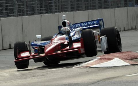 Up and Over//Race cars are not supposed to fly, even though they travel at jetlike speeds. But sometimes hitting a curb can upset the balance a bit, as seen by Alex Tagliani hopping a curb during qualifying at Infineon Raceway recently.