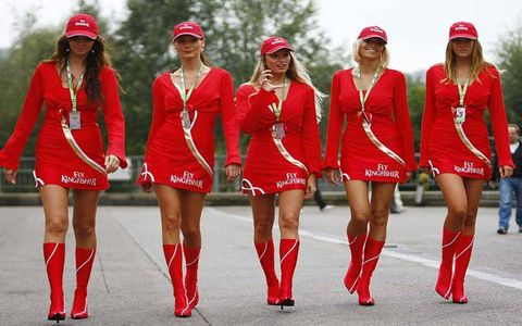 Dress, Red, Cap, Headgear, Team, Costume accessory, Street fashion, Coquelicot, Holiday, Day dress,