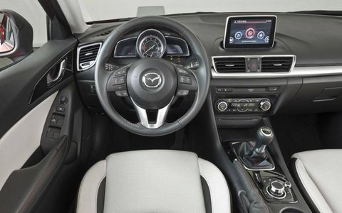 Motor vehicle, Steering part, Automotive design, Mode of transport, Product, Steering wheel, Automotive mirror, Center console, White, Vehicle audio,