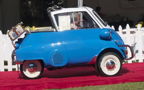 Nevada City teacher Brian Powers leaves the stand in his school's winning BMW Isetta 300 Cabriolet.