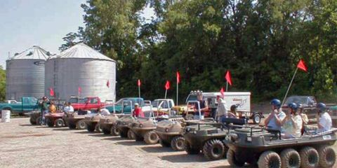 A group of modern-day amphibious all-terrain vehicle (AATV) enthusiasts gather before hitting the trail.