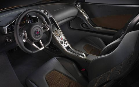 Motor vehicle, Mode of transport, Automotive design, Steering part, Steering wheel, Red, Car, Car seat, Center console, Vehicle door,
