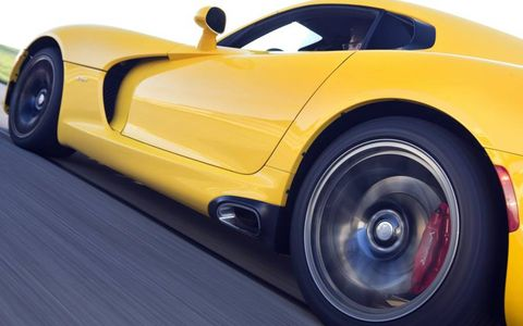 The 2013 SRT Viper retains its signature side exhaust pipes.