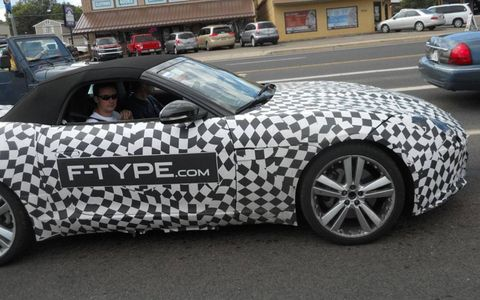 """Under cover: The camouflage and large """"F-Type.com"""" sticker seem to be designed to draw the eye."""