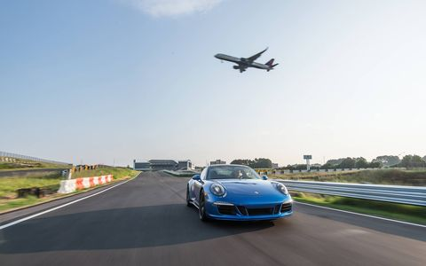 Built in the footprint of an old Ford factory Porsche has turned the location into its North American headquarters with an owner experience center that has its own track.