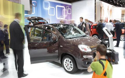 Motor vehicle, Automotive design, Vehicle, Event, Land vehicle, Car, Exhibition, Auto show, Automotive wheel system, Alloy wheel,