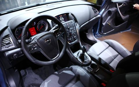 Motor vehicle, Steering part, Automotive design, Mode of transport, Product, Steering wheel, Red, White, Technology, Center console,