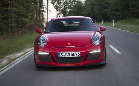 Road, Automotive design, Mode of transport, Vehicle, Automotive lighting, Land vehicle, Car, Red, Vehicle registration plate, Performance car,