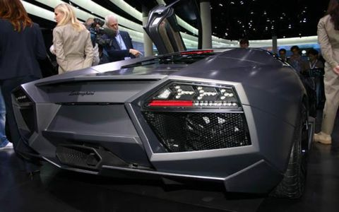 Automotive design, Event, Automotive exterior, Supercar, Car, Concept car, Sports car, Luxury vehicle, Personal luxury car, Jacket,
