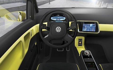 Motor vehicle, Mode of transport, Transport, Yellow, Automotive design, Steering part, Steering wheel, Vehicle door, Fixture, Vehicle audio,