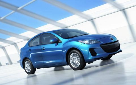 The mildly redone 2012 Mazda 3 i Grand Touring sedan is a handsome car from the outside. The deep blue color matched well with the beige leather interior.