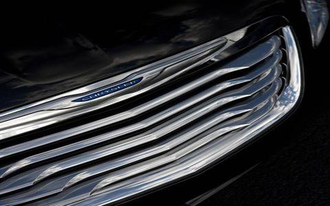 Automotive exterior, Automotive design, Grille, Automotive lighting, Headlamp, Hood, Light, Electric blue, Bumper, Personal luxury car,