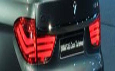 Motor vehicle, Automotive design, Automotive tail & brake light, Mode of transport, Automotive exterior, Red, Automotive lighting, Photograph, White, Car,