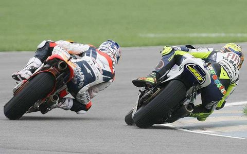 Valentino Rossi Fiat Yamaha Team battles with Nicky Hayden Repsol Honda Team for the lead.