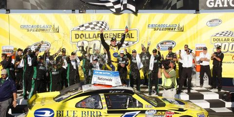Rickey Stenhouse poses in victory lane after his big Nationwide win at Chicago.