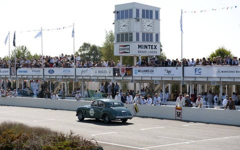 1954 Jaguar Mk VII make its way past the pit straight during a race Saturday.
